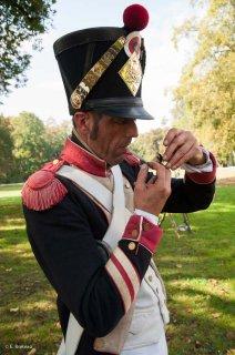Reconstitution d'un bivouac des troupes napoléoniennes au château du Passage en Isère. Allumage d'une pipe dans les conditions de l'époque