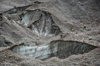 Vallon du Vénéon. Glacier de Bonne Pierre recouvert d'un pierrier.